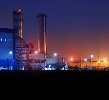 High voltage power station at night.